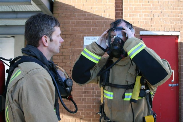 John Penrose meeting firefighters and taking part in training exercise