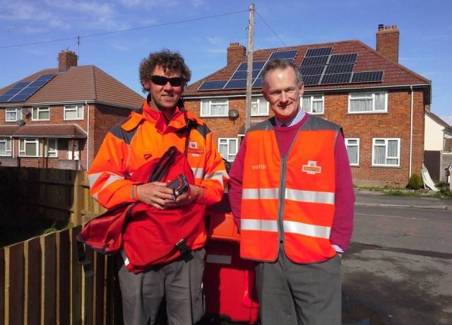John out on rounds with local postman, Stephen Jones.